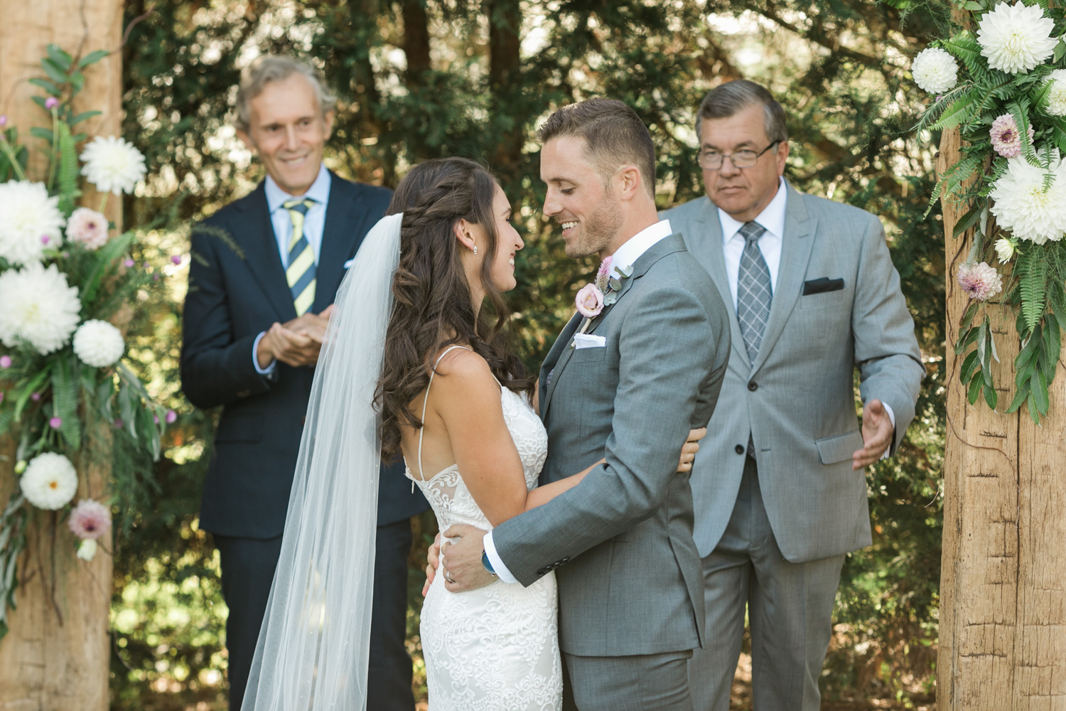 image of bride and groom first kiss at private residence wedding ceremony in Gettysburg