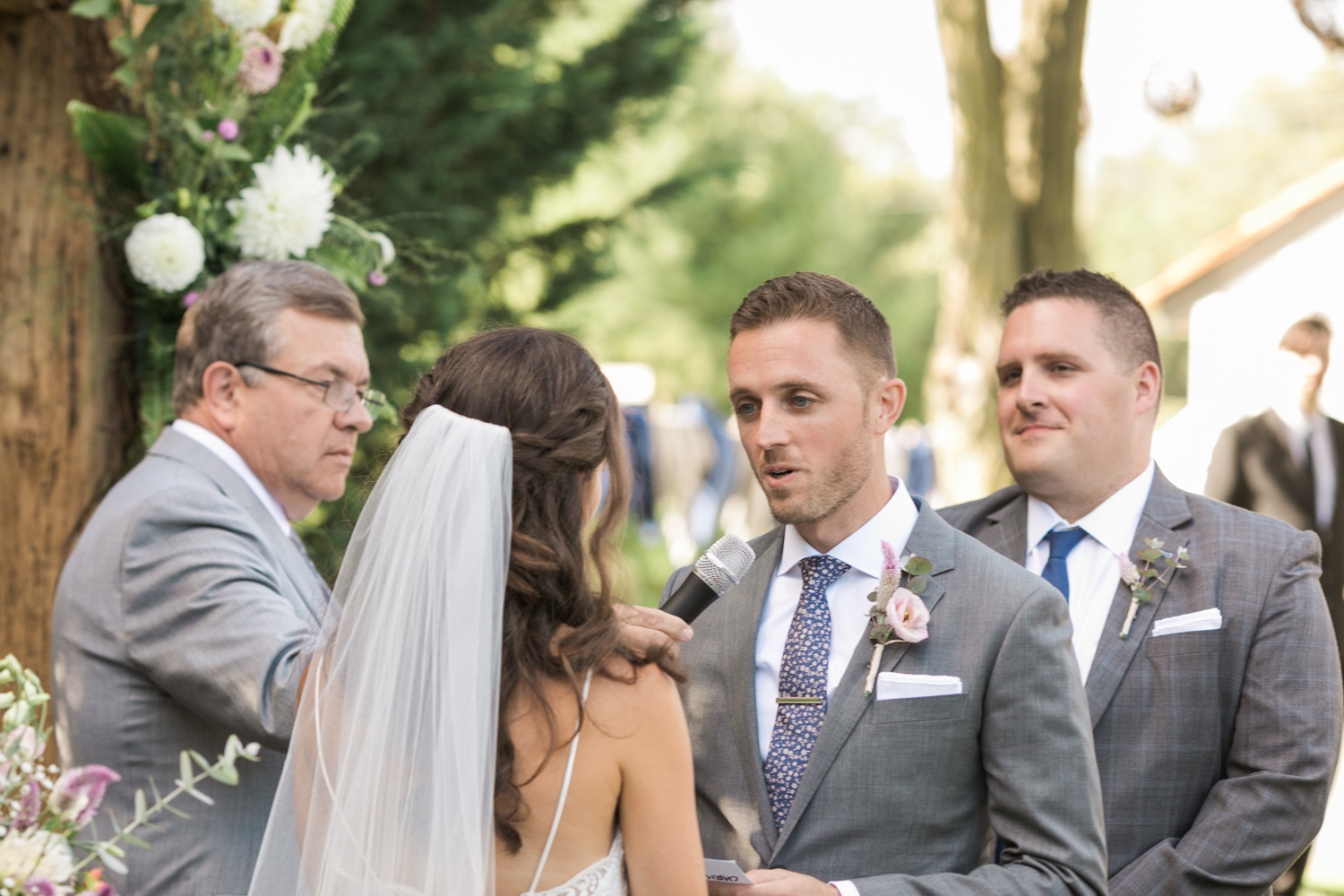 image of groom exchanging vows at private residence wedding ceremony