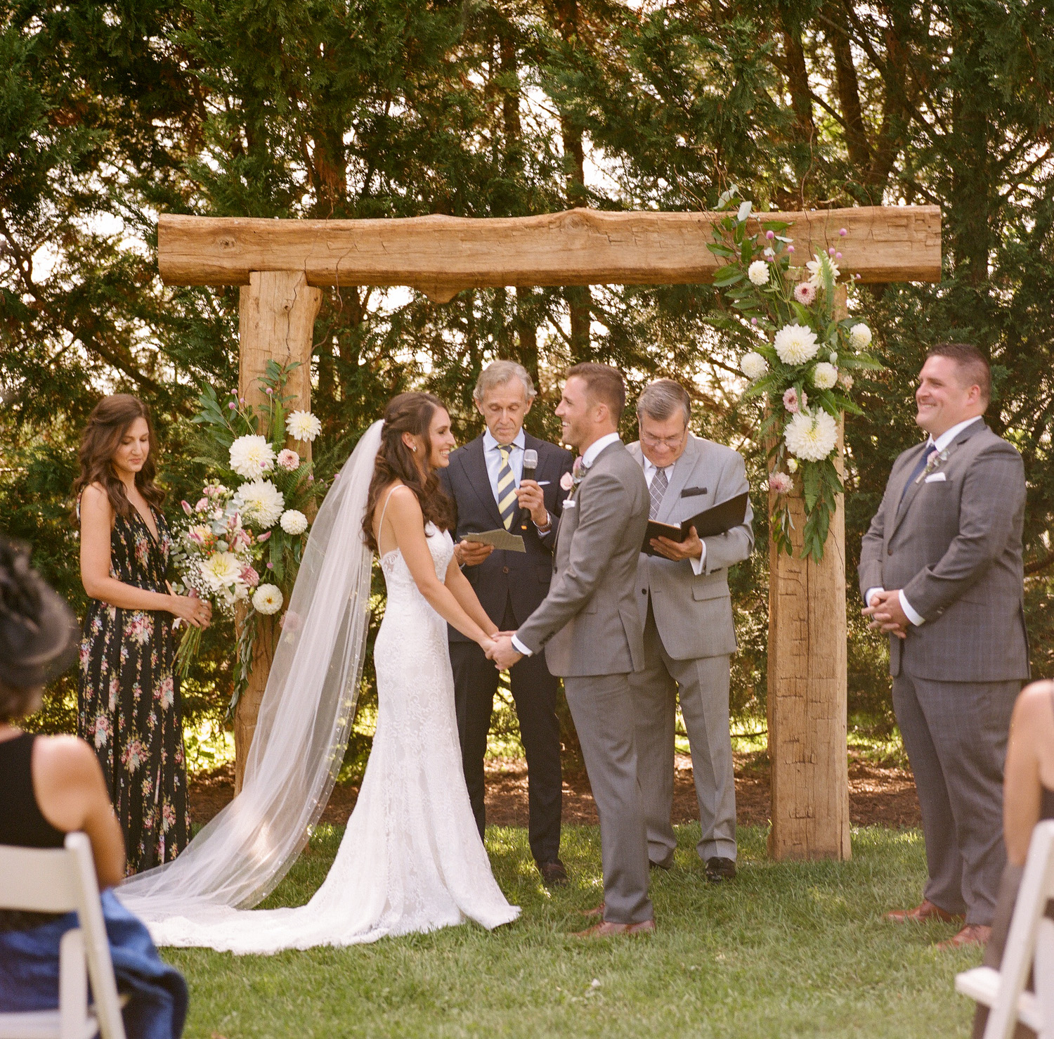 image of bride and groom under arch at wedding ceremony at private residence in Gettysburg