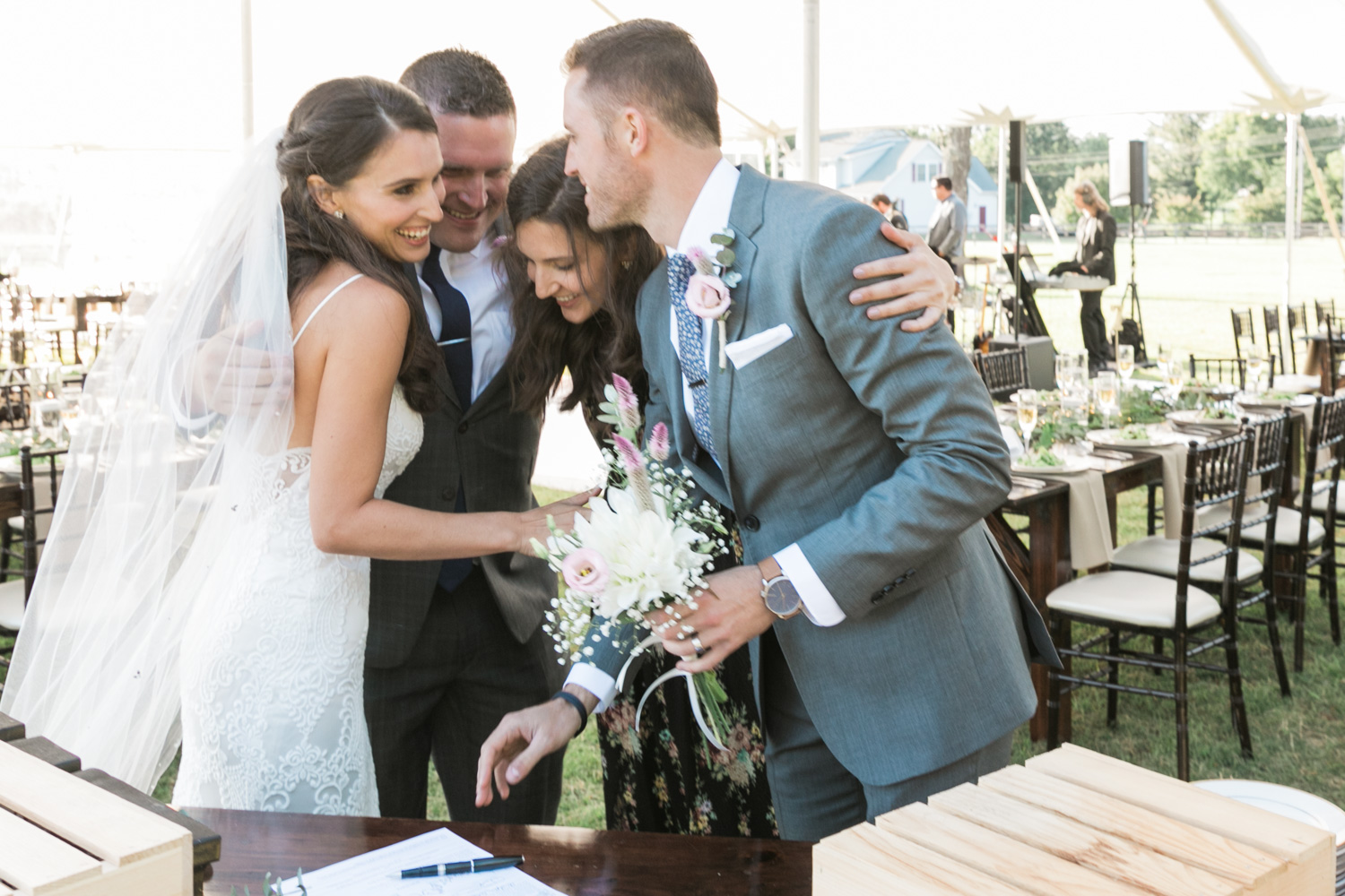 image of bridal party celebrating marriage certificate signing at Gettysburg wedding ceremony