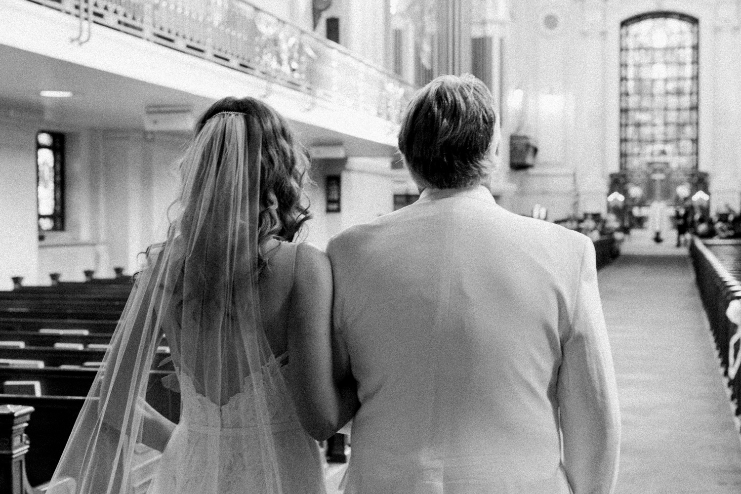 image of bride and father entrance wedding ceremony at US Naval Academy chapel in black and white
