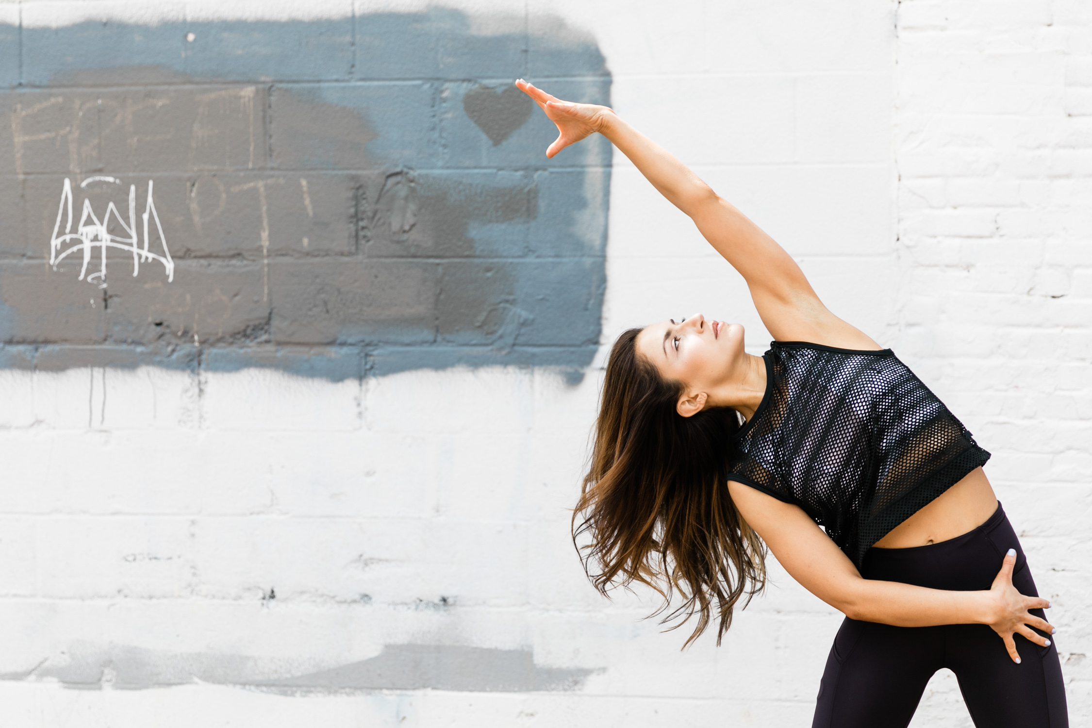 image of Flywheel instructor Hannah Bornstein in Blagden Alley in Washington DC photographed by Tracey Salazar