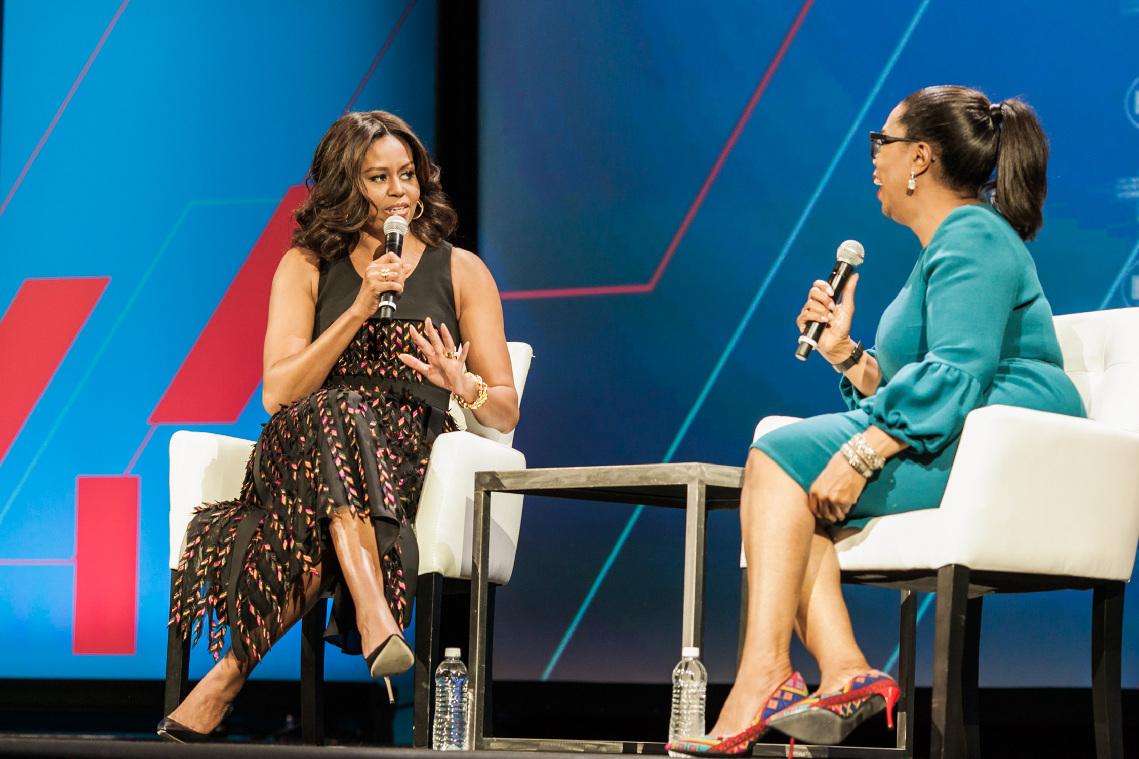 image of Michelle Obama and Oprah Winfrey at United State of Women White House Summit in Washington DC