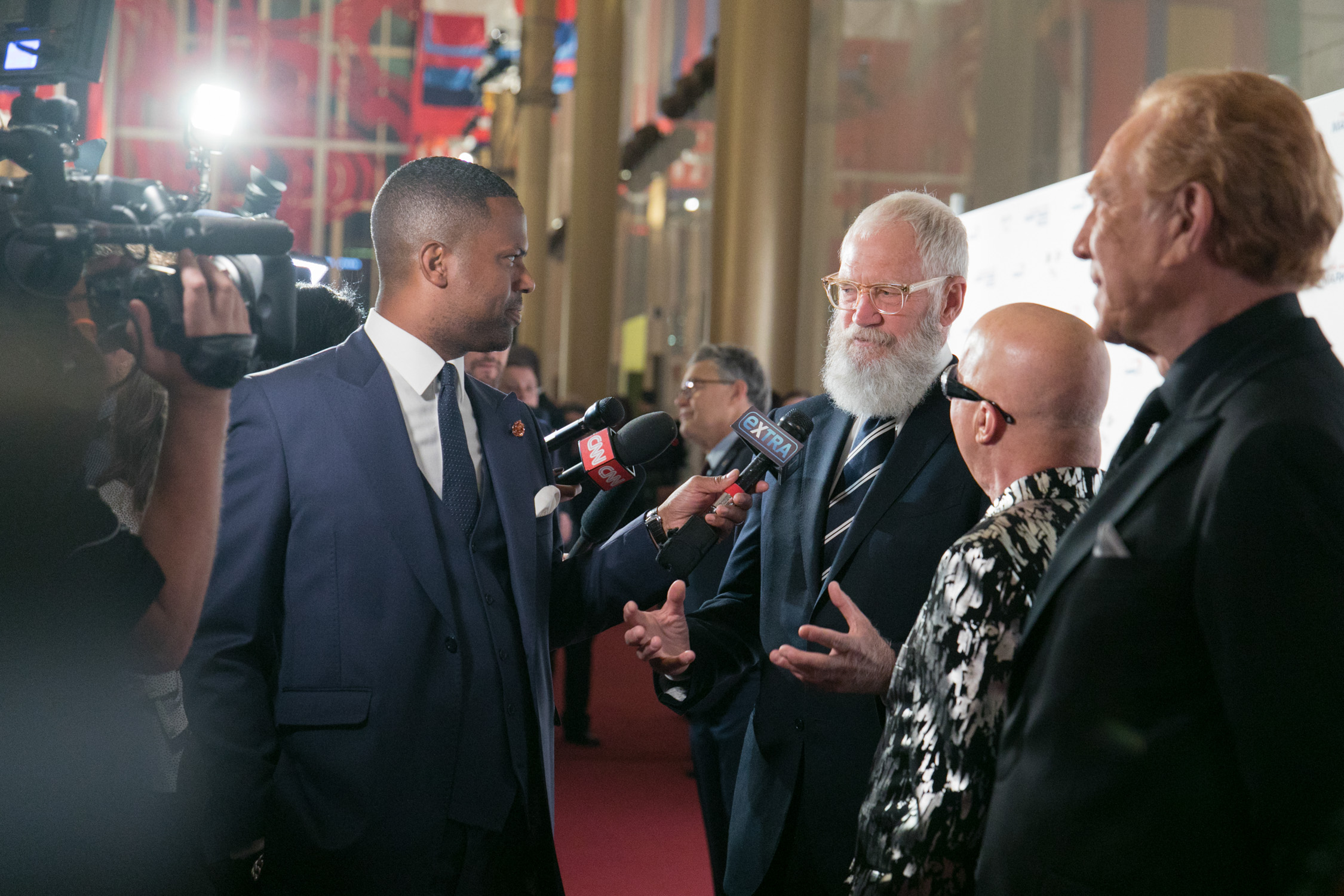 image of David Letterman Paul Schaffer Alan Watts being interviewed by AJ Calloway for Extra TV at Mark Twain Prize Awards at Kennedy Center in Washington DC