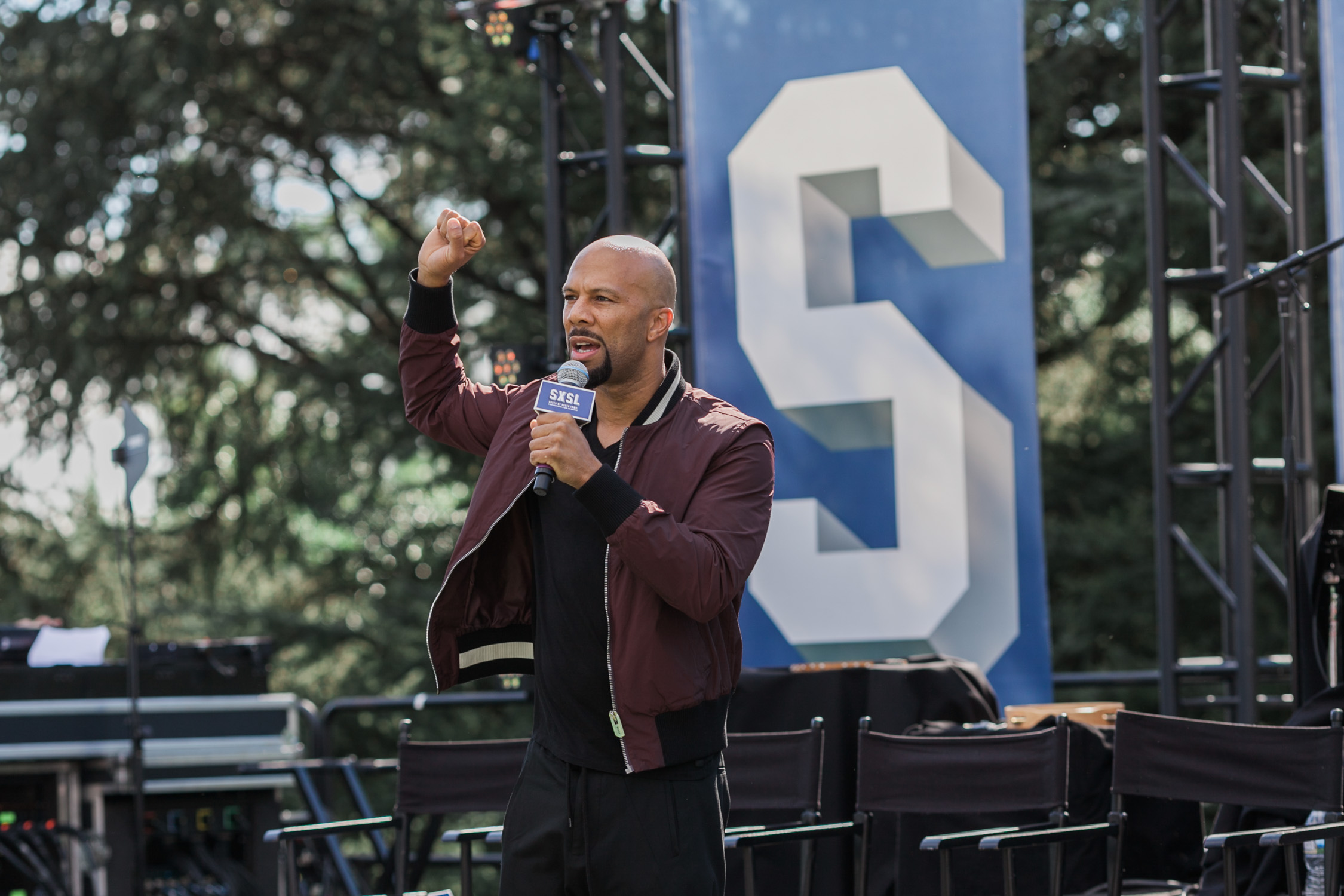 image of Common at SXSW festival during Obama Administration on South Lawn of the White House