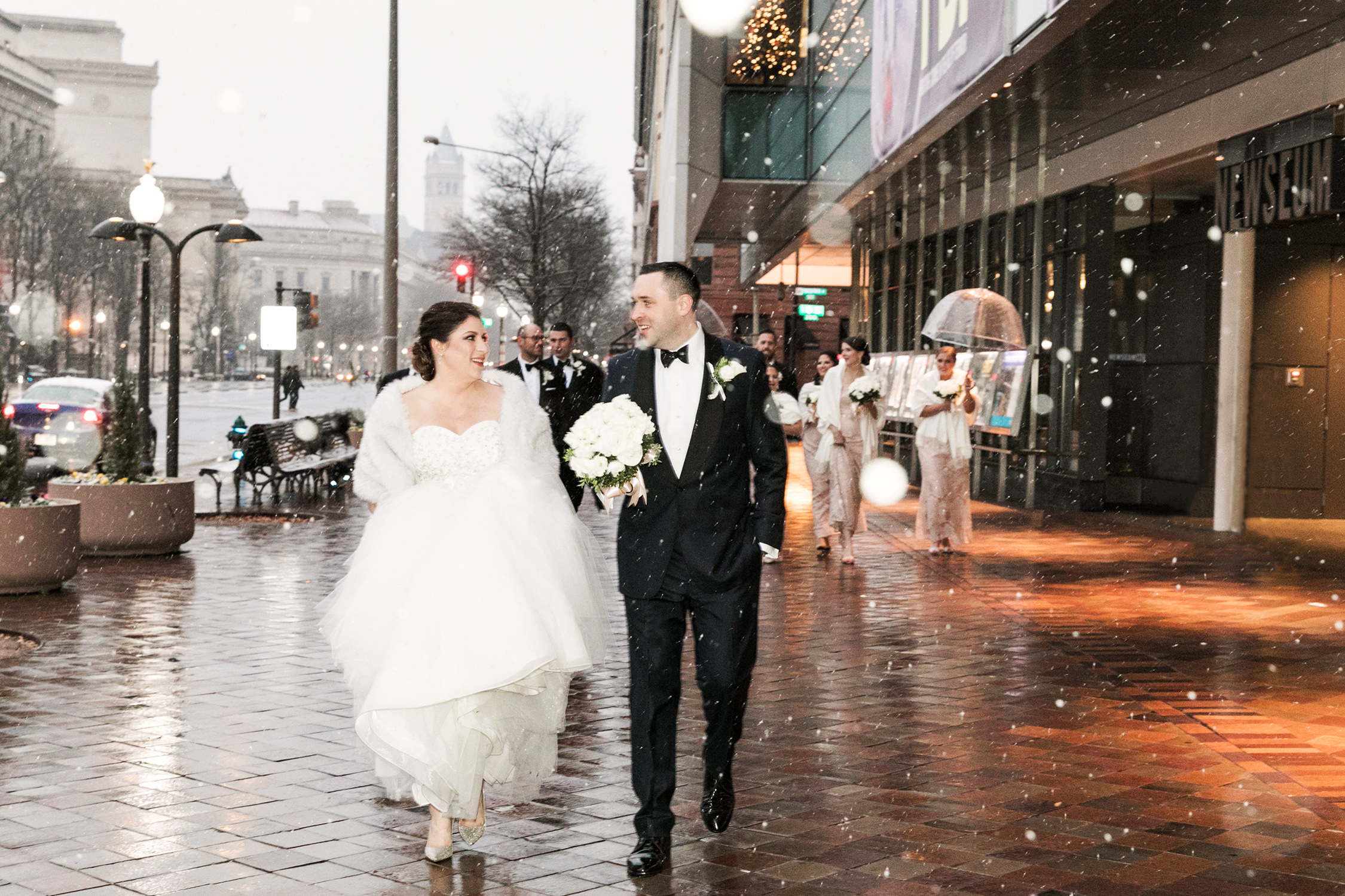 image of winter wedding party at Newseum in Washington DC
