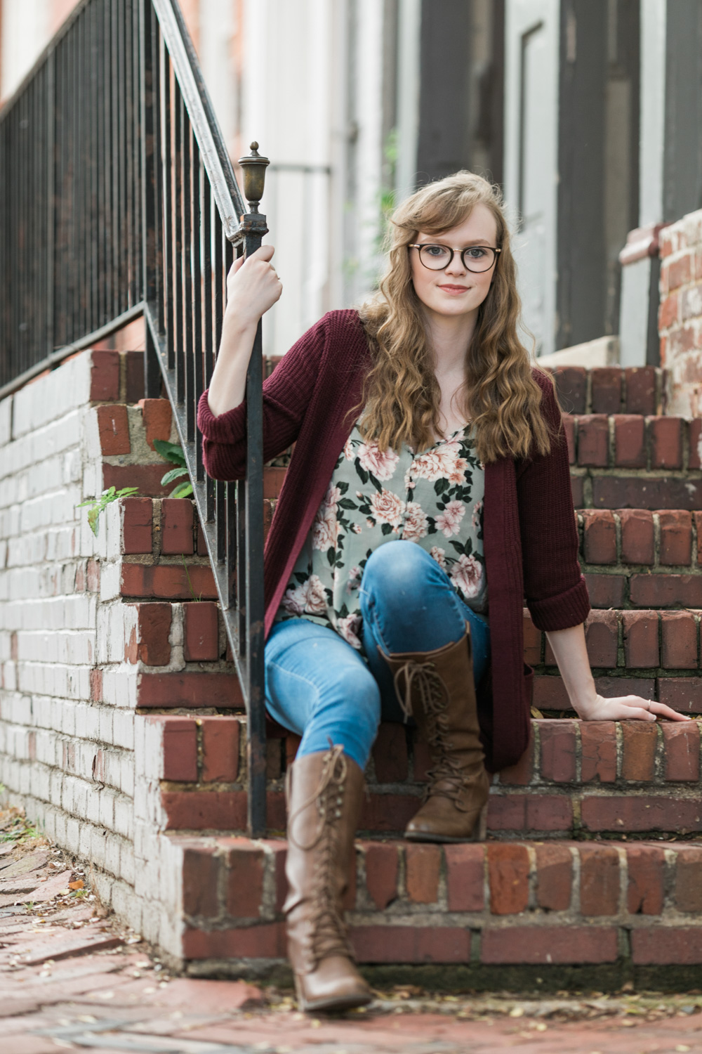 image of senior portrait girl with glasses in old town Alexandria Virginia
