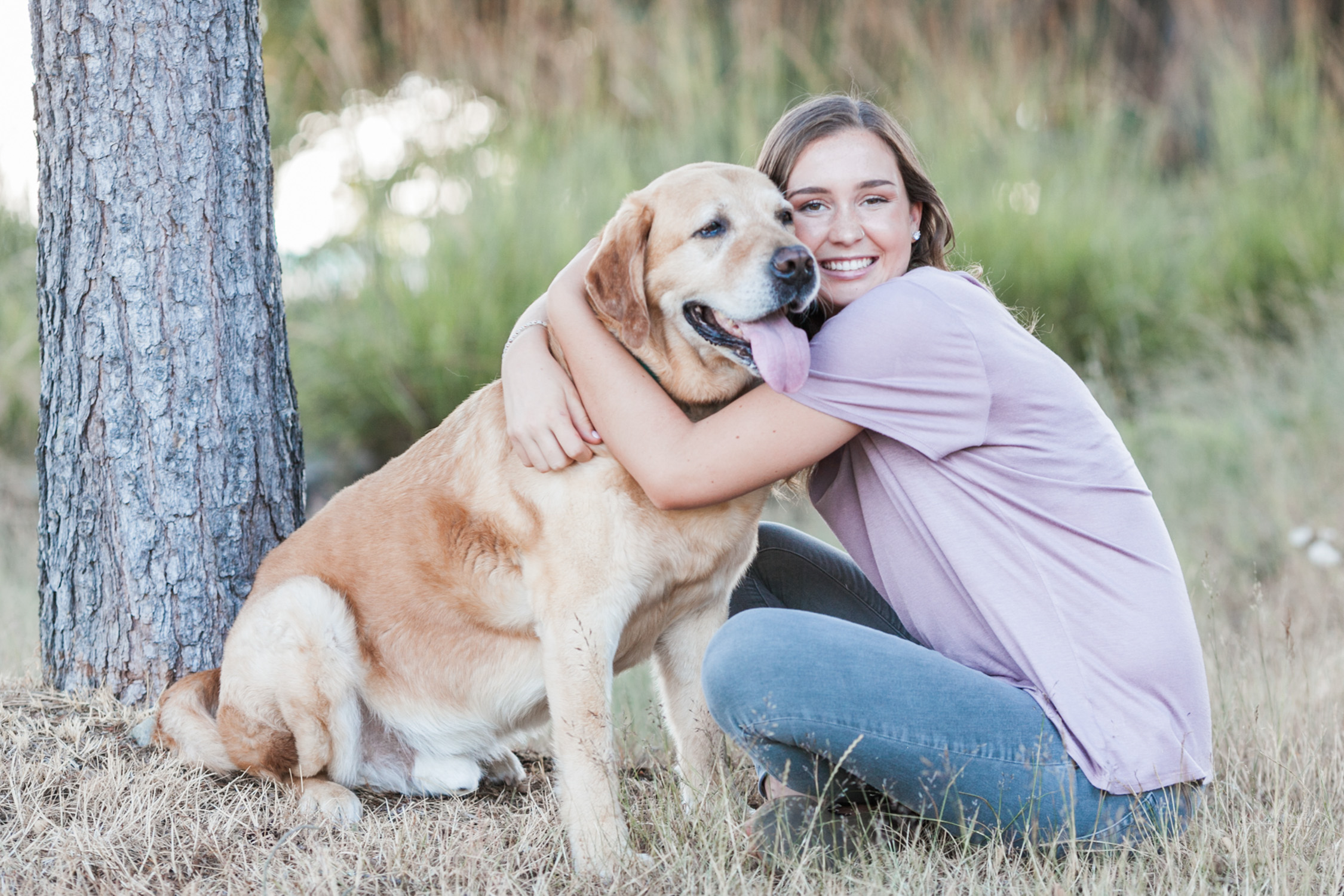 image of senior portrait girl with dog at Chambers Bay in University Place