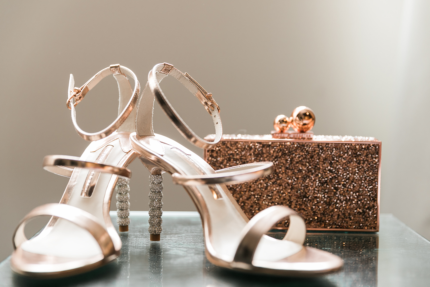 image of Tudor Place wedding detail rose gold wedding shoes and clutch purse