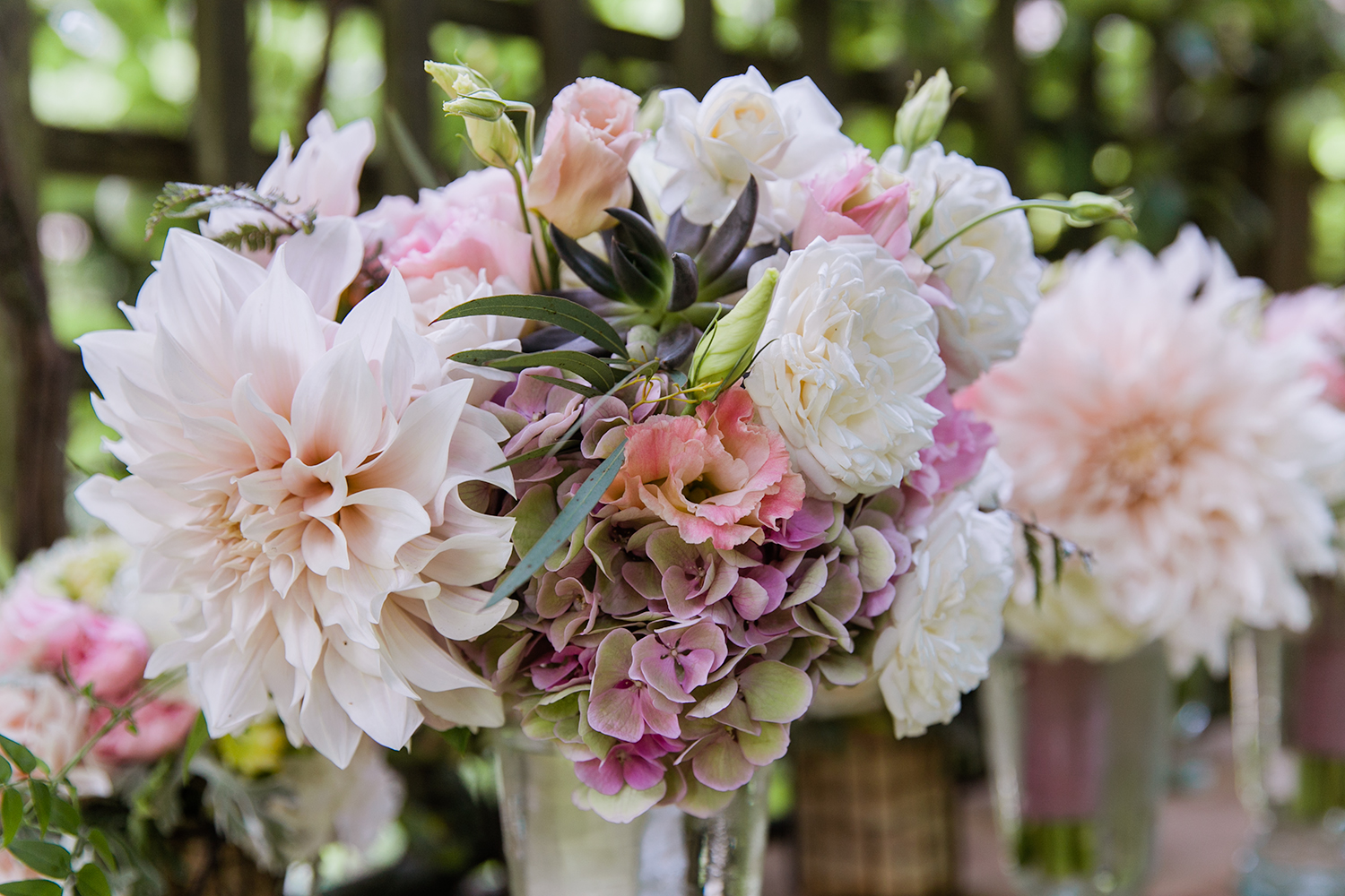image of wedding bouquet and bridal party flowers by Garden Party Flowers of Bainbridge Island florist TJ Montague