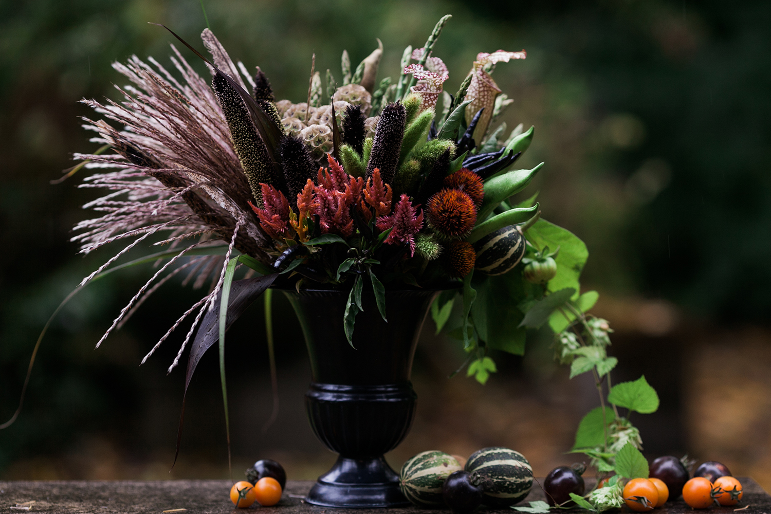 image of creative edible fall and winter floral arrangement with vegetables by Garden Party Flowers of Bainbridge Island florist TJ Montague