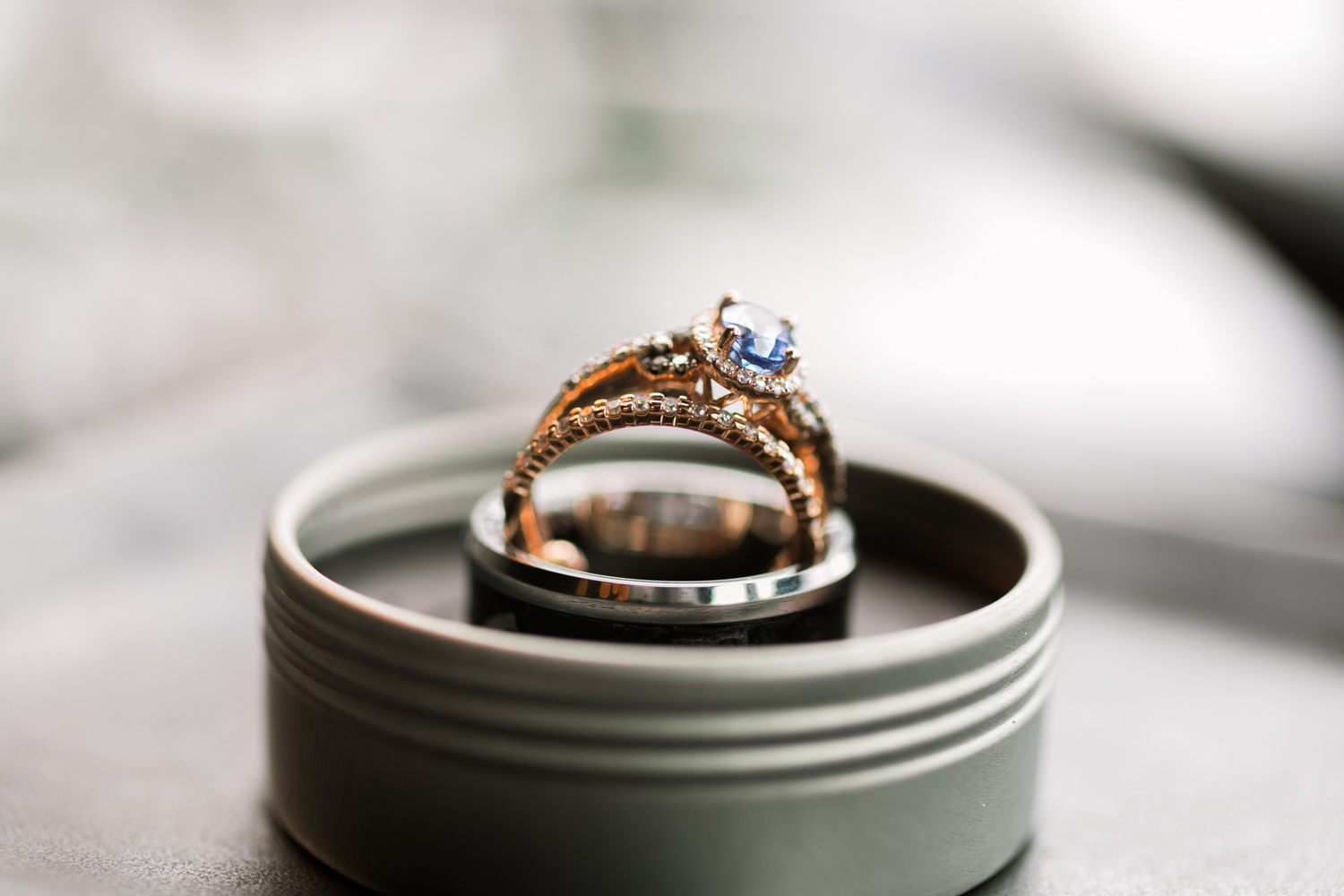 image of Canlis wedding rose gold and sapphire and diamond wedding ring detail