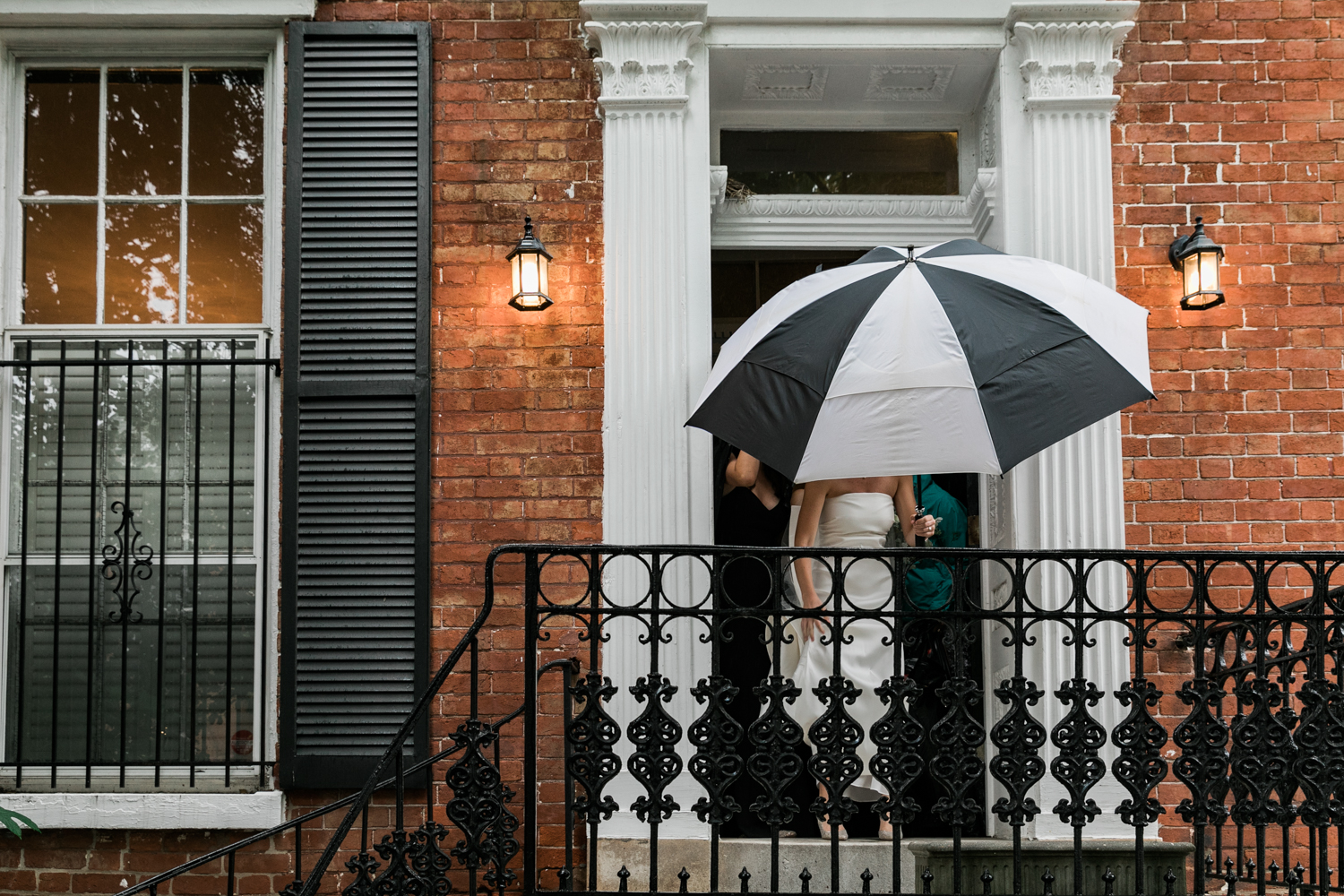 Georgetown wedding - Classic bride with umbrella in DC